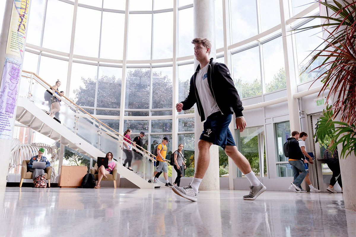 Students walking in large open atrium
