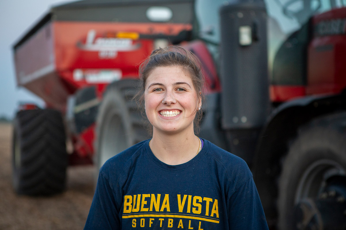 Student in front of tractor