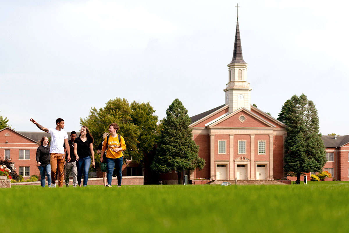 Students walk in front of chapel