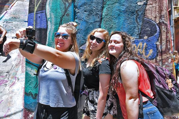 Students take a selfie while on a city tour