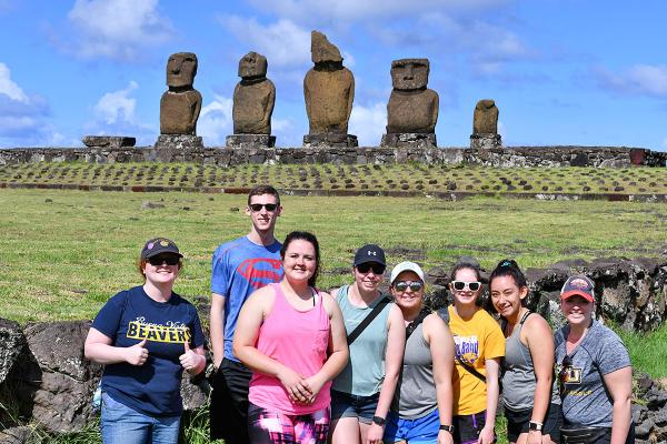 Students in front of Easter Island heads