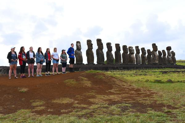 Students in line with Easter Island heads