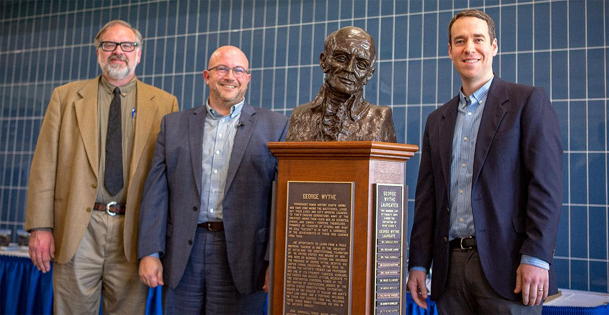Jerry Johnson, President Joshua Merchant, and Dr. Nathan Backman