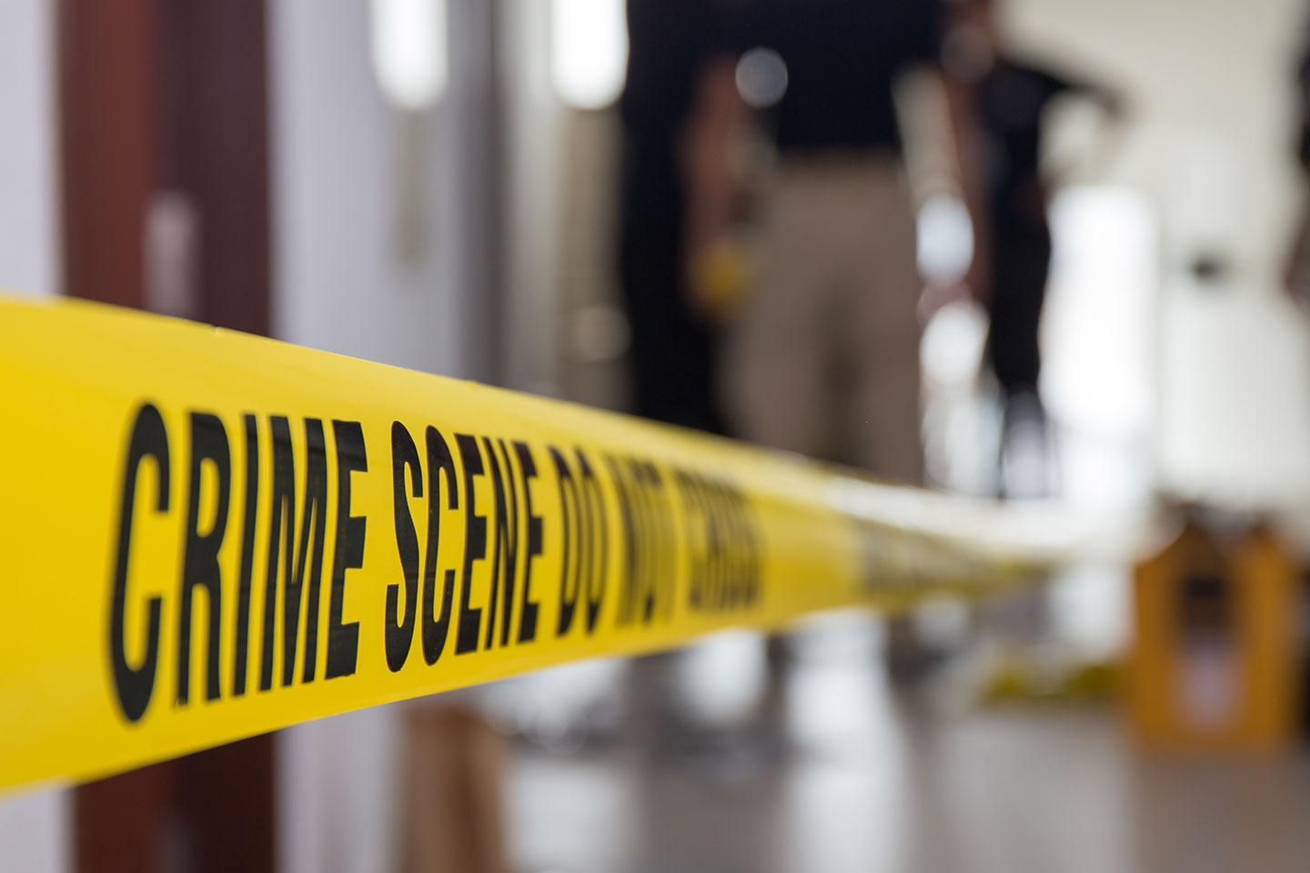 A crime scene with police tape