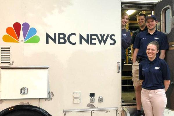 Students in an NBC News live truck