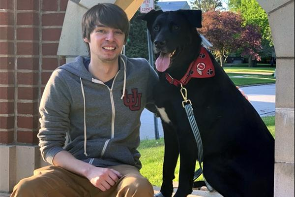 Nate Strohmyer and his dog, Vigilance